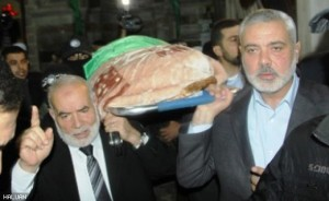 Prime Minister Ismail Haniyeh (right) and other leaders at the funeral.